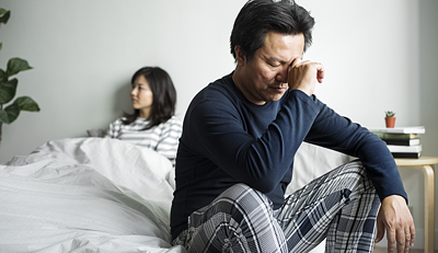 Man in bed with wife - frustrated - narrow