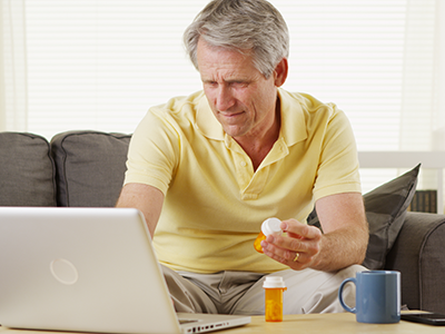 Man looking up BPH meds on computer